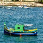 Maltese Luzzu in St Julian's Bay, north Malta